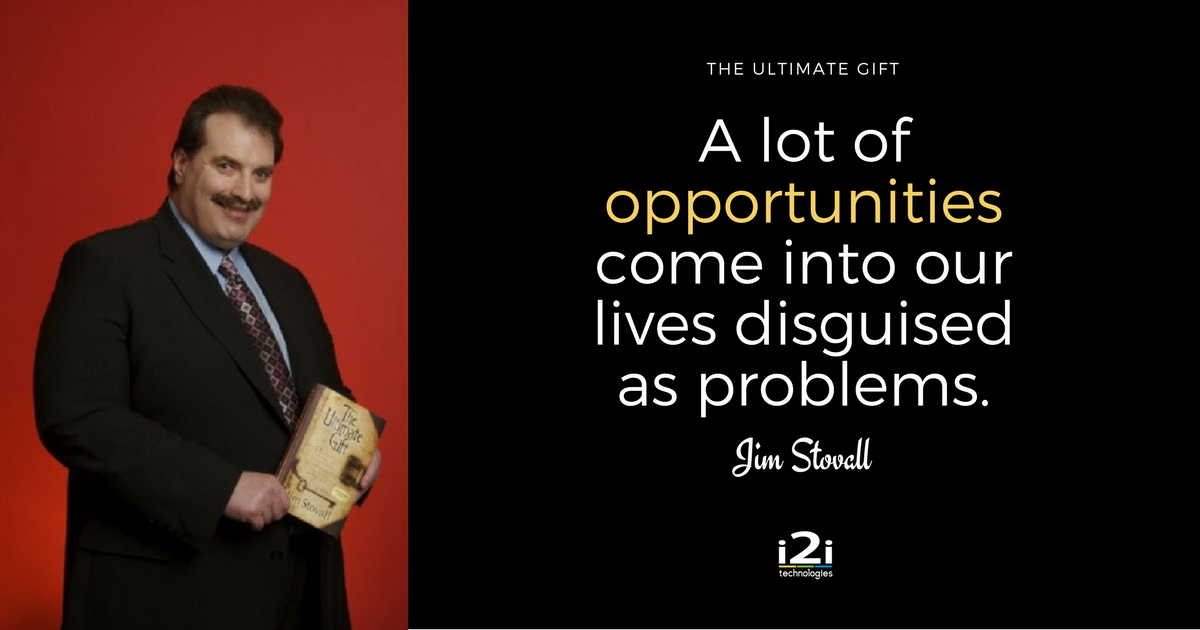 "Jim Stovall holding a book. ""A lot of opportunities come into our lives disguised as problems."""