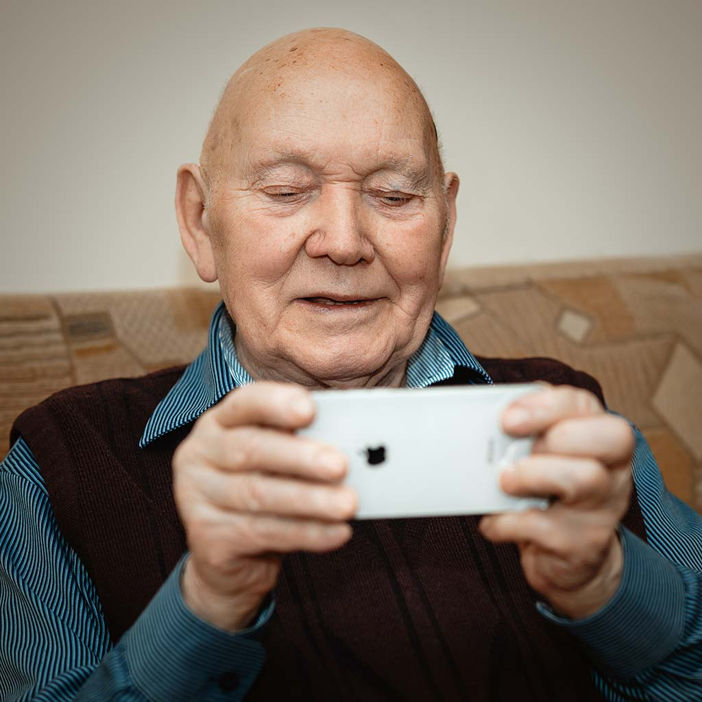 Older man video chatting with i2i technologies team